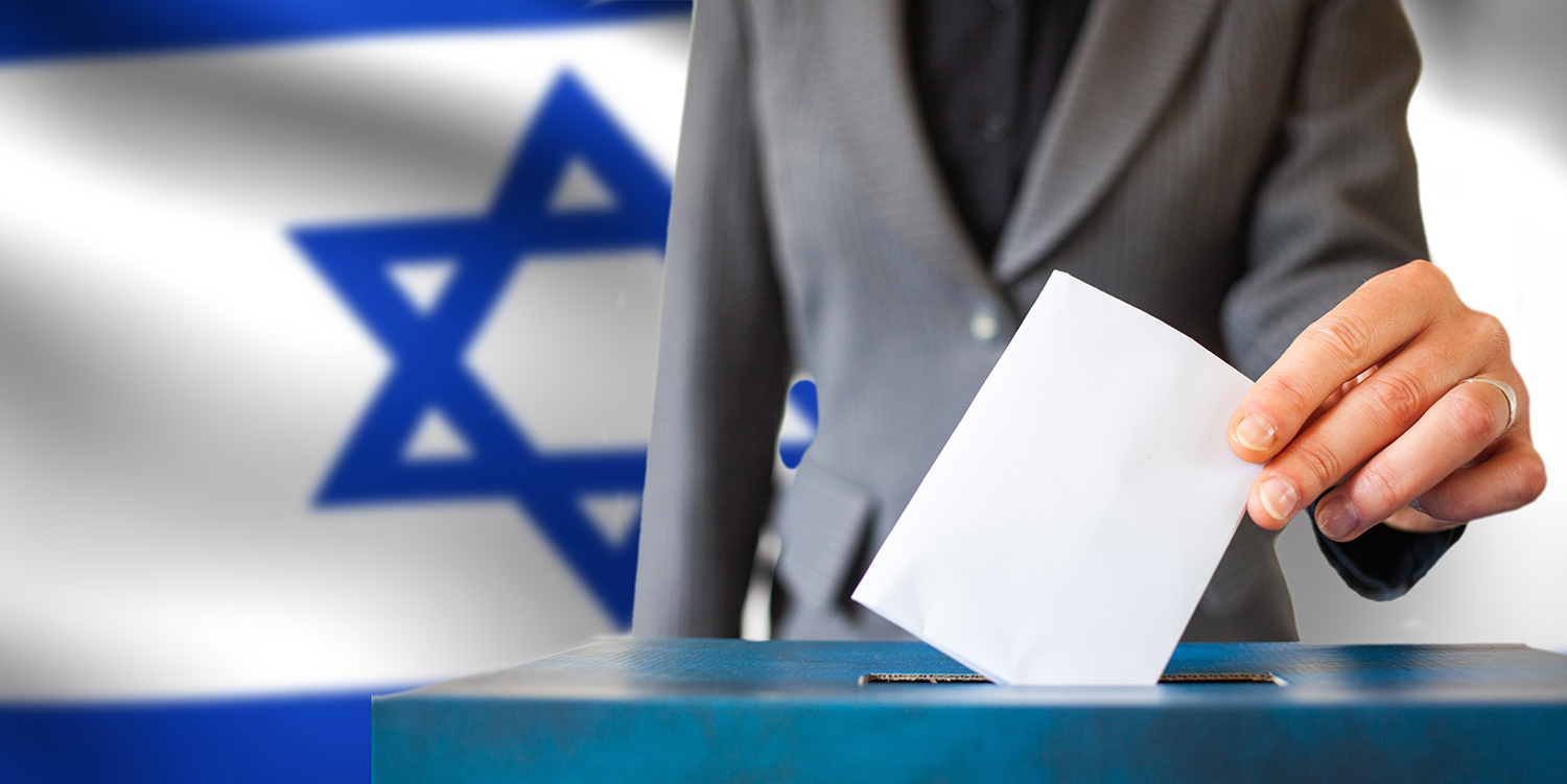 israel elections hand putting vote in ballot