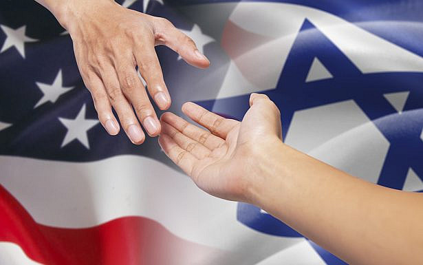 Hand pulling a person hand and giving a help in front of american and israel flags