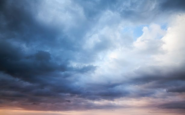 Dark blue stormy cloudy sky. Natural photo background