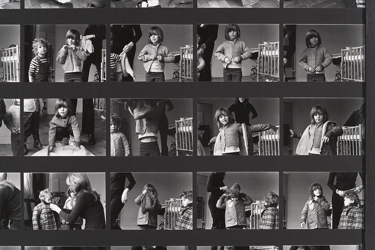 Mierle Laderman Ukeles, Dressing to Go Out/Undressing to Go In, 1973, detail. Black-and-white photos mounted on foam core with chain and dust rag, 55 x 42 1/4 inches. Original black-and-white photographs: Joshua Siderowitz. Installation photo: Jeffrey Sturges © Mierle Laderman Ukeles. Courtesy the artist and Ronald Feldman Gallery, New York, NY